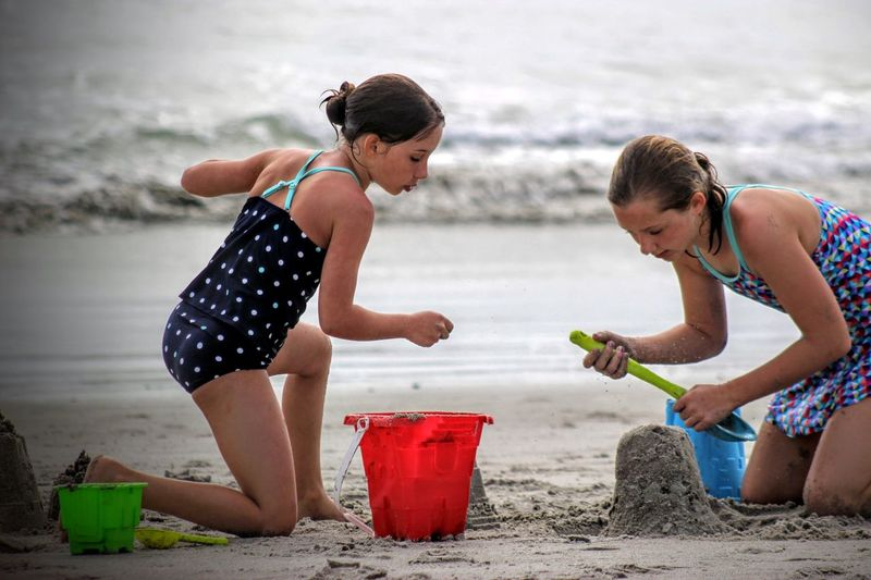 Girls building sandcastle