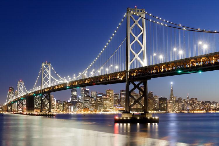 Blue hour over the bay bridge and the city. yerba buena island, san francisco, california, usa