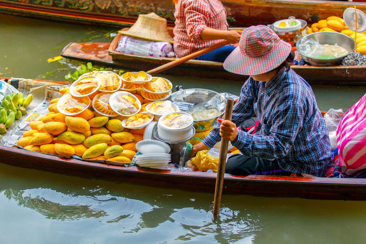 Midsection of woman holding food in lake