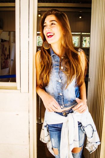 Smiley girl. One Person Only Women One Woman Only Casual Clothing Adults Only Front View Young Adult Adult People One Young Woman Only Open Smiling Day Confidence  Cheerful Doorway Standing Young Women Outdoors Business Teenage Girls Teen Jeans Smile