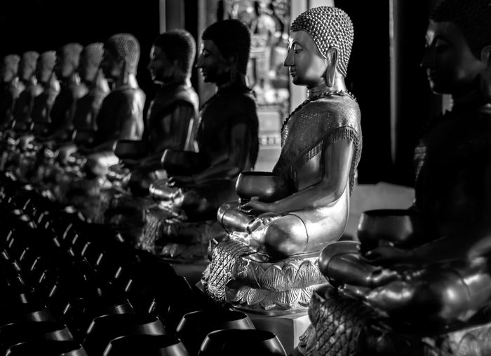 Black And White Buddha Statue Religion ASIA Asian  Faith Indoors  Human Representation Representation Statue Sculpture Male Likeness Art And Craft Creativity Belief Spirituality In A Row No People Craft Focus On Foreground Architecture Built Structure Building Idol Nightlife