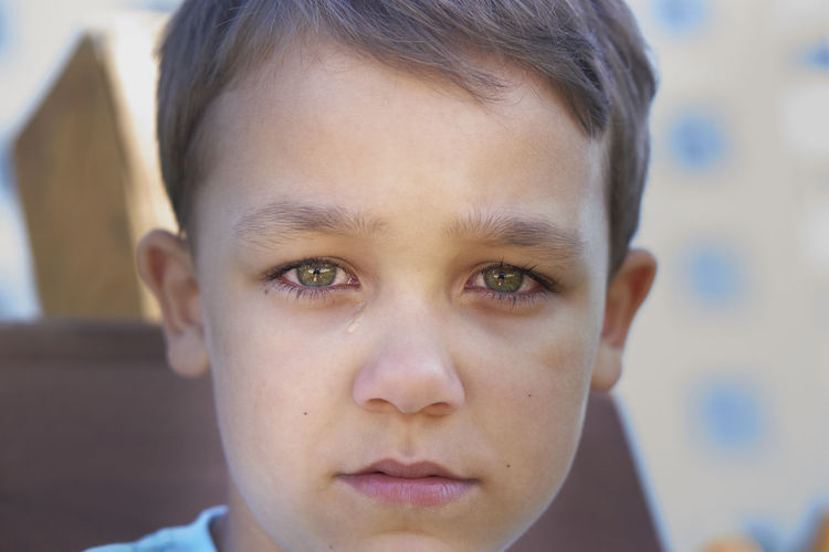 Close-up portrait of sad boy