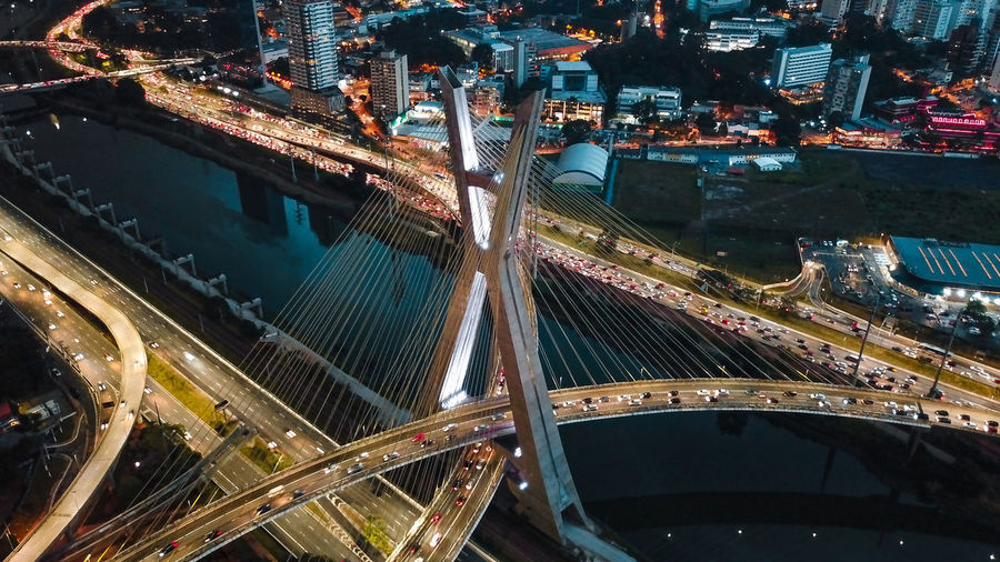 Aerial view of illuminated bridges in city at night