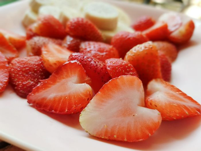 Close-up of chopped strawberries in plate