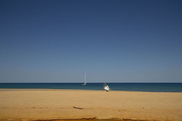 Landscape view of piscinas beach with a sail and tourist
