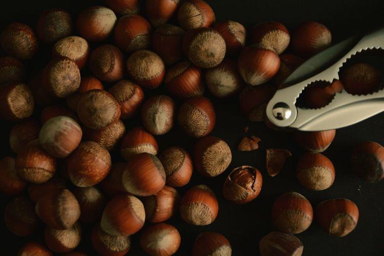 Full frame shot of hazelnuts with nutcracker