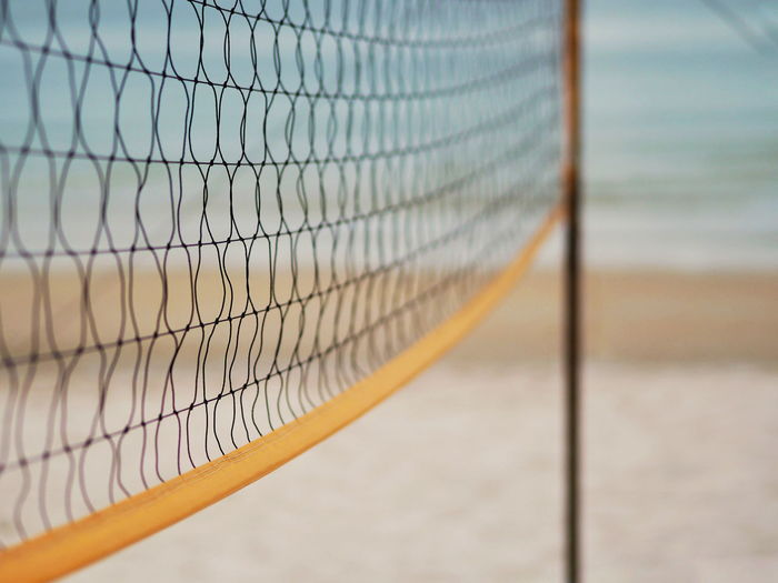 Close-up of net at beach