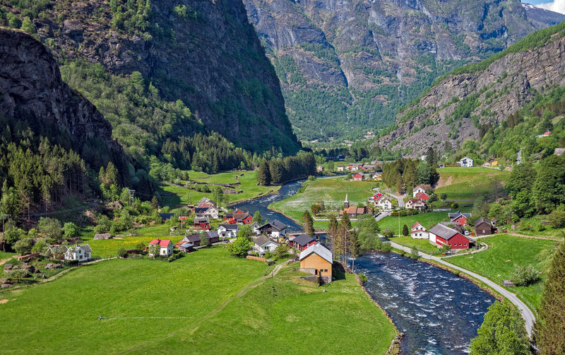 Beautiful small village at Flam, Norway. Norway Architecture Beauty In Nature Building Building Exterior Built Structure Day Domestic Domestic Animals Environment Field Flam Village Grass Green Color House Land Landscape Mountain Nature Outdoors Plant Scenics - Nature Tree