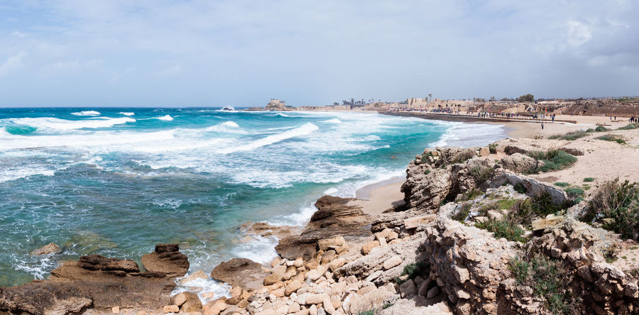 Small storm on the Mediterranean Sea on the promenade of Caesarea in the old town in Israel Ancient Archaeological Architecture Beach Building Caesarea Coast Coastline Day Herod Israel Landscape Mediterranean  National Nature No People Outdoors Roman Ruins Sea Shore Sky Tourism Travel Water