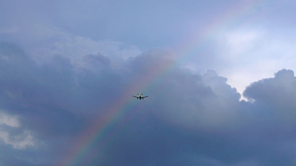 Urlaubsträume Holiday Aerobatics Aerospace Industry Air Vehicle Airplane Cloud - Sky Day Distant Flying High Up Journey Low Angle View Mid-air Mode Of Transportation Motion Nature No People on the move Outdoors Plane Rainbow🌈 Sky Transportation Travel