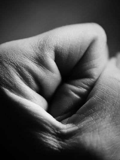 Skin Fist Emotion Emotions Gesture Human Hand Hand Human Body Part Body Part Close-up Human Finger Finger Love Positive Emotion Two People People Bonding Indoors  Real People Adult Unrecognizable Person Family Black Background Care