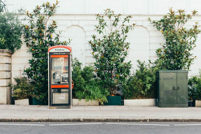 View of telephone booth on sidewalk