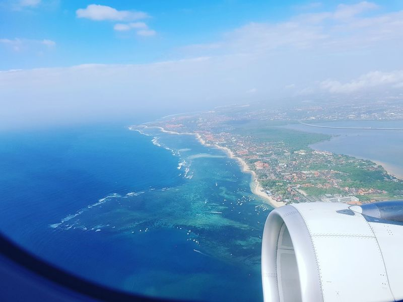 Bali Airplane Aerial View Flying Travel Sea Island Bali, Indonesia Transportation Journey Air Vehicle Water Cloud - Sky Business Finance And Industry Mode Of Transport Blue Mid-air Travel Destinations No People Commercial Airplane Aircraft Wing Jet Engine Sky INDONESIA