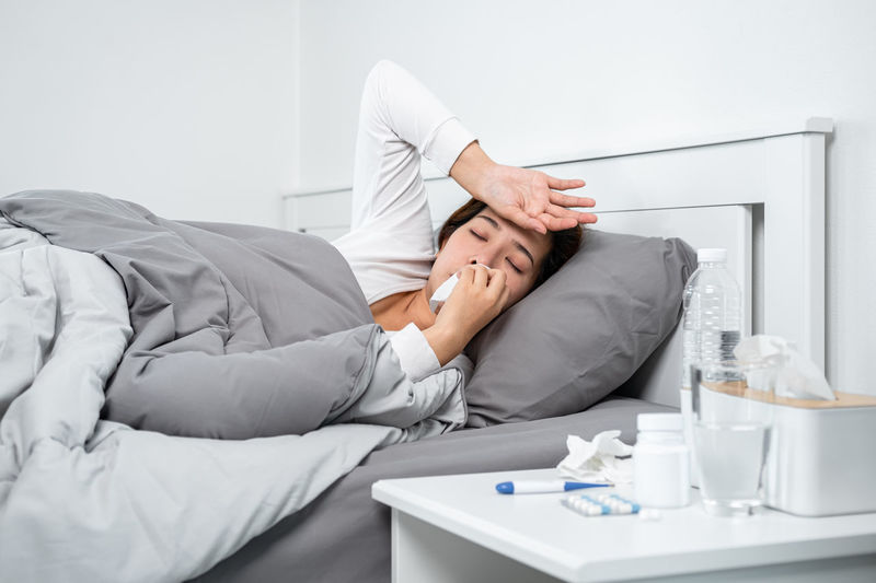 Midsection of man lying down on bed