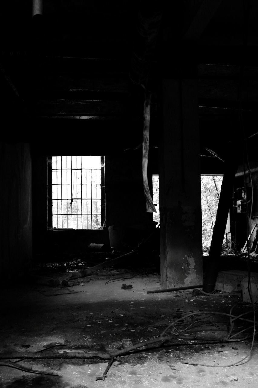Abandoned Interior With Window In Distance