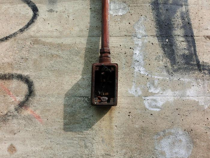 Abandoned fuse box on wall