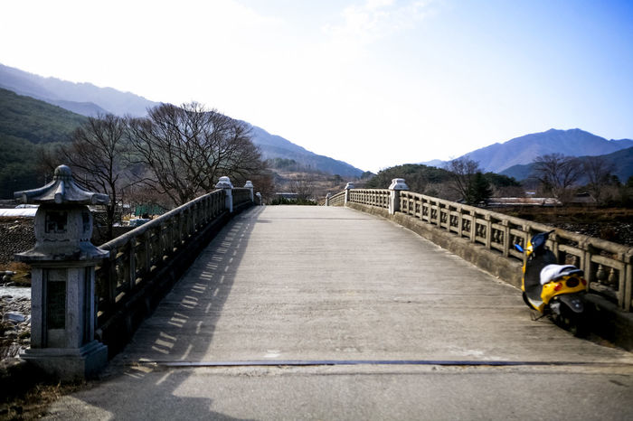 Absence Bridge Bridge - Man Made Structure Built Structure Canal Composition Connection Day Diminishing Perspective Jirisan Leading Long Narrow No People Outdoors Perspective Railing River Road Silsangsa The Way Forward Tranquility Transportation Water Winter