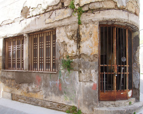 derelict art deco building in nicosia cyprus Cyprus Derelict Nicosia Architecture Building Building Exterior Built Structure City Day Door Entrance Façade History House No People Old Outdoors Residential District Ruined Stone Material The Past Wall - Building Feature Weathered Window