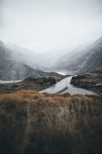 Mountain Landscape Environment Beauty In Nature No People Sky Nature Scenics - Nature Road Day Transportation Fog Tranquility Non-urban Scene Tranquil Scene Outdoors Cold Temperature Winding Road Land