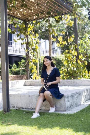 Young woman sitting in yard