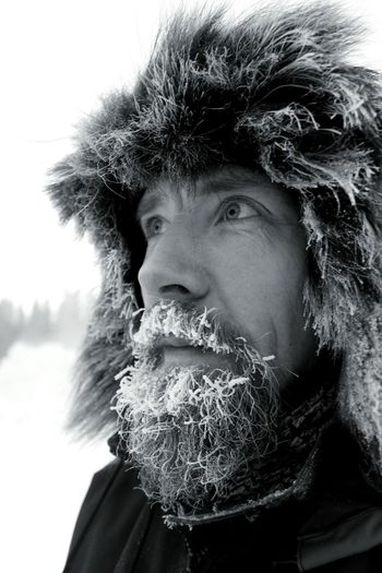 Close-Up Of Man Wearing Warm Clothing Looking Away During Winter