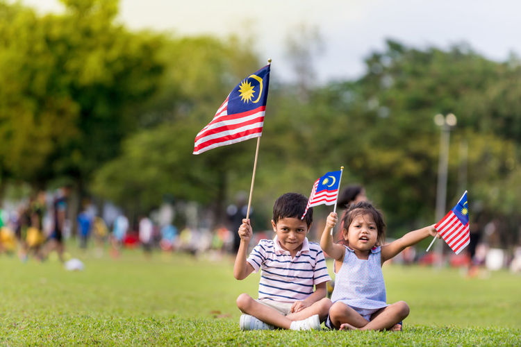 Boy and girl playing with flag