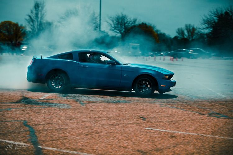 What's better then the smell of fuel and burning rubber. Burnout Ford Mustang Race Car Motor Vehicle Mode Of Transportation Transportation Land Vehicle Street City No People Nature Road Day Smoke - Physical Structure Motion Sign Architecture Outdoors