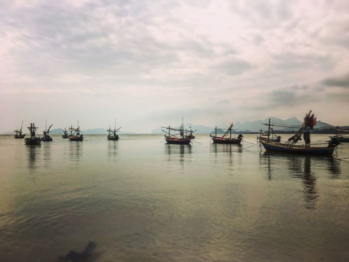 Water Nautical Vessel Transportation Sky Mode Of Transportation Cloud - Sky Waterfront Nature Sea Scenics - Nature Fishing Industry Fishing Boat No People Outdoors Reflection Beauty In Nature Moored Tranquil Scene
