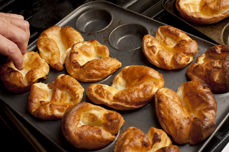 High angle view of yorkshire puddings in baking sheet