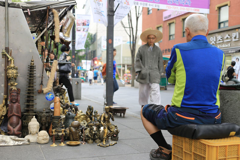 Insadong area, well known as a traditional street to both locals and foreigners Lifestyle Road Shopping Tourist Worship Adult City Customer  Display Hawker Insadong Leisure Market Men Retail  Retail Display Seller Shopping Sitting Street Traditional Street Vintage