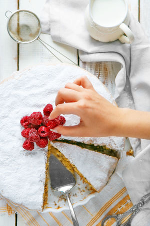 Arranging sponge cake with berries. Top view Arranging Bake Bakery Berlin Cat Confectionery Crumbs Cute Fresh Fruit Gourmet Hand Homemade Pastry Photography Plant Raspberry Relaxing SLICE Sponge Sport Sugar Table Tasty Vanishing Point