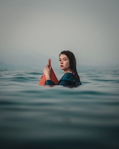 Portrait Of Young Woman With Buoy In Sea
