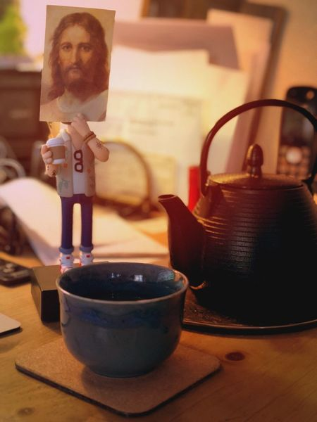 Green Tea with Jesus. Jesus Indoors  Table Teapot Tea - Hot Drink Focus On Foreground Drink Close-up