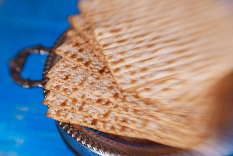 Passover Jewish Matzah on Decorated Silver Plate. Closeup Selective soft focus Jewish Passover Passover Food Jewish Holiday Kiddush Kosher Kosher Food Matzo Matzoh Jewish Passover Plate Passover Seder Religious Celebration Unleavened Bread