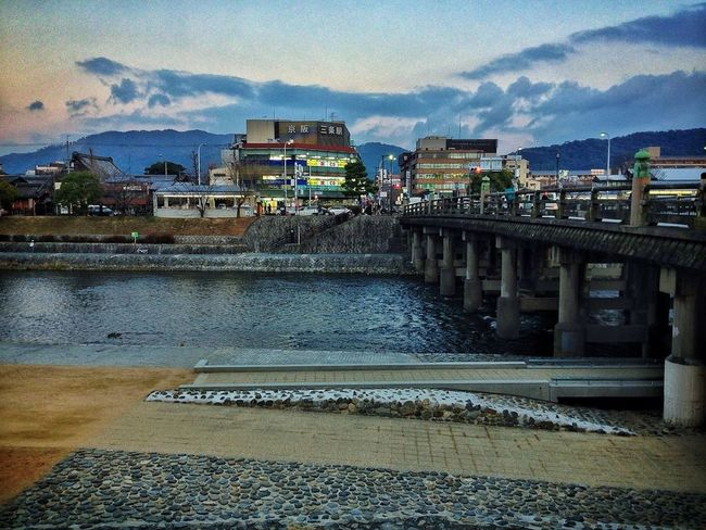 Sitting on the terrace at dusk. Starbucks by Sanjo bridge on Wednesday. Overlooking the Kamo river and eastern Kyoto.
