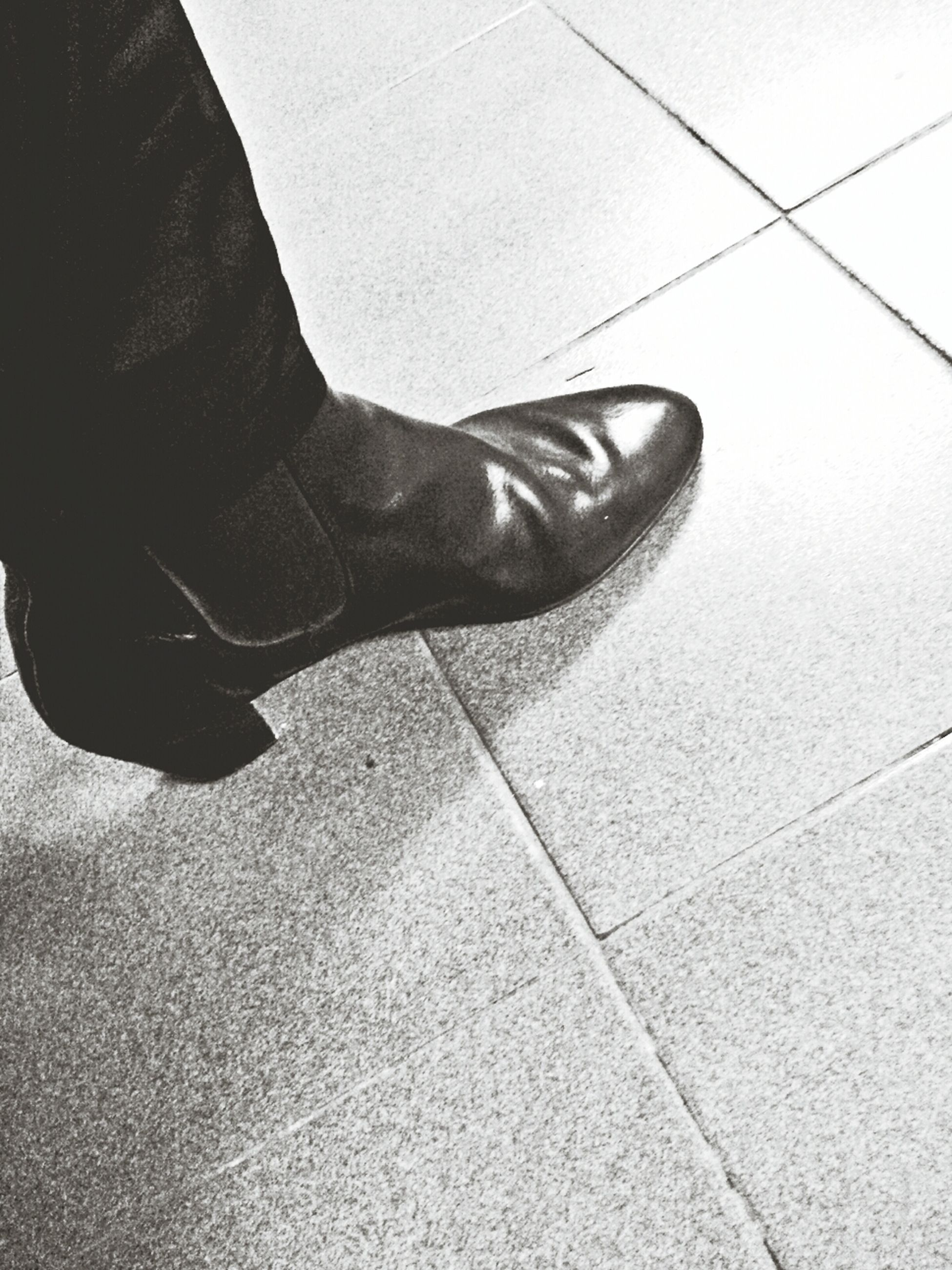 low section, person, lifestyles, leisure activity, men, shoe, part of, human foot, shadow, standing, high angle view, tiled floor, personal perspective, sunlight, unrecognizable person