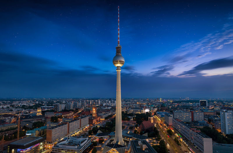 Fernsehturm Amidst Illuminated City At Night