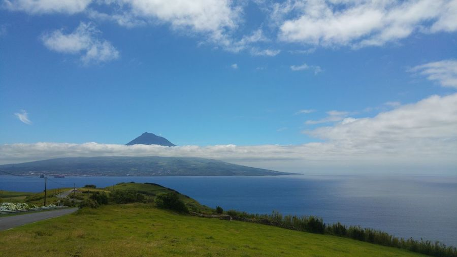 Scenic view of sea and pico island against sky