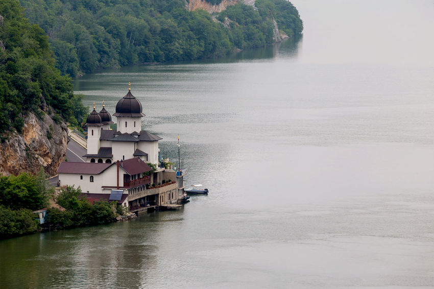 Summer landscape of Danube Gorge, at the border between Romania and Serbia Colors Danube Dubova. Gorge Monastery Mraconia Road Romania Serbia Transportation Boat Coast Danube România Danube River Defilé Foggy Morning Landscape Misty Morning Orsova Orthodox Summer Travel Destinations