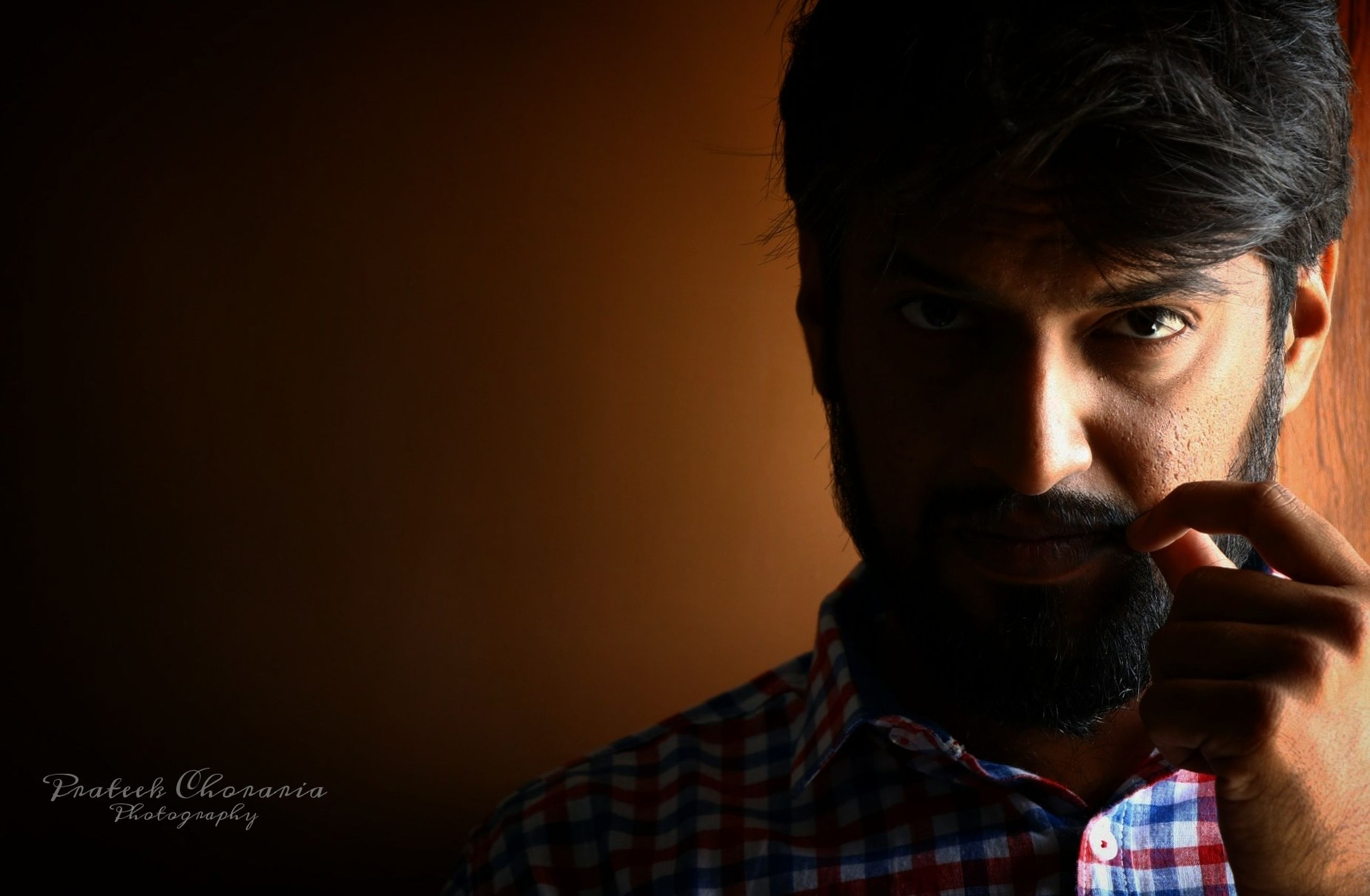 portrait, one person, headshot, young men, lifestyles, young adult, indoors, real people, facial hair, copy space, beard, front view, looking, communication, technology, close-up, looking at camera, body part, human face, mustache