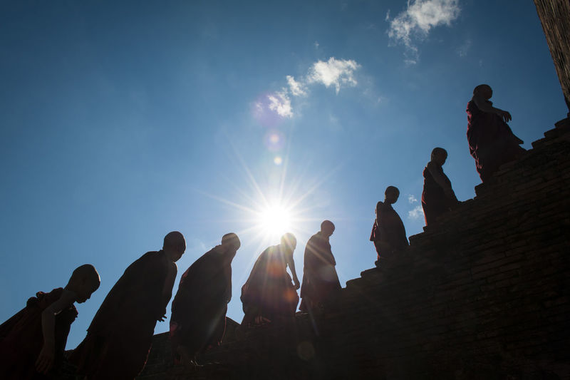 Monks walking in line. Blu Sky With Cloud Day Large Group Of People Low Angle View Men Monks Outdoors People Real People Religion Sky Sun Sunlight Togetherness Travel Destinations