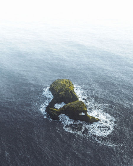 High angle view of rock formation on beach