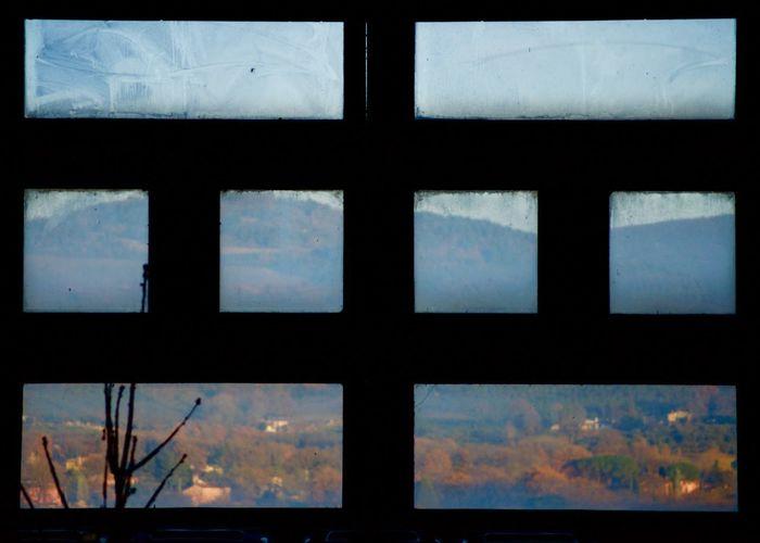 Full frame shot of glass window against blue sky