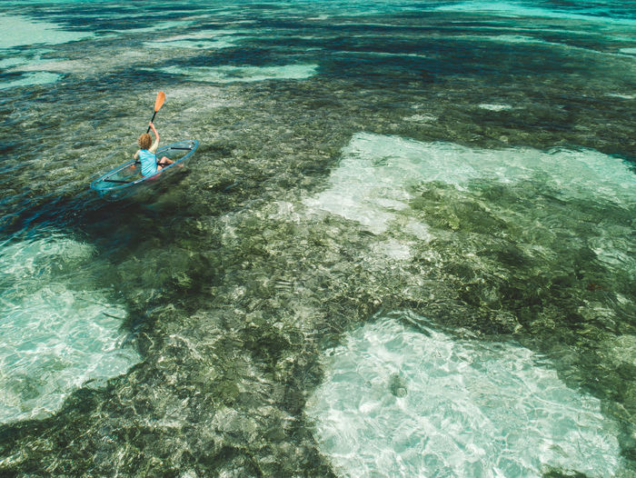 High angle view of woman on inflatable boat in sea