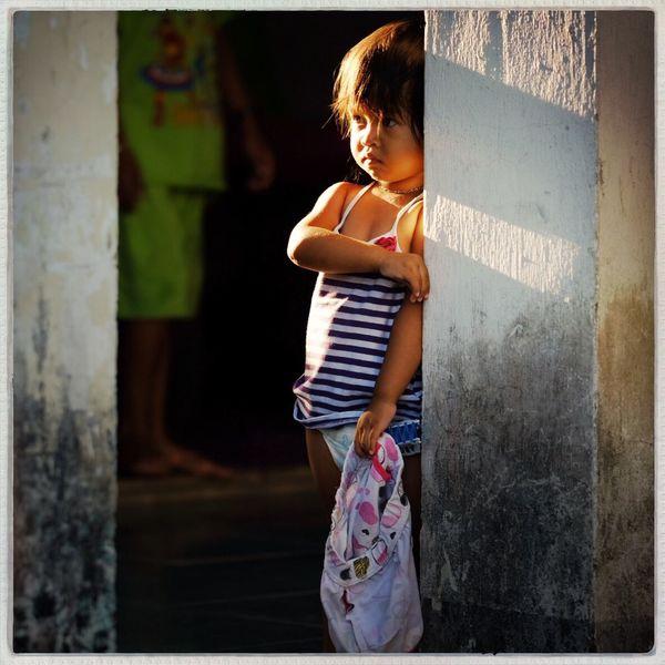 Vietnamese girl in the morning light, HoiAn, Vietnam Child Travel