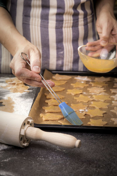 sprinkle biscuits with eggs Hand Holding Preparation  Indoors  Kitchen Table Food Bowl Kitchen Utensil Preparing Food Dough Women Mixing Sprinkle Biscuits Cookies Christmas Advent Eggs Kekse Backen Backblech Rolling Pin Female Bestreichen