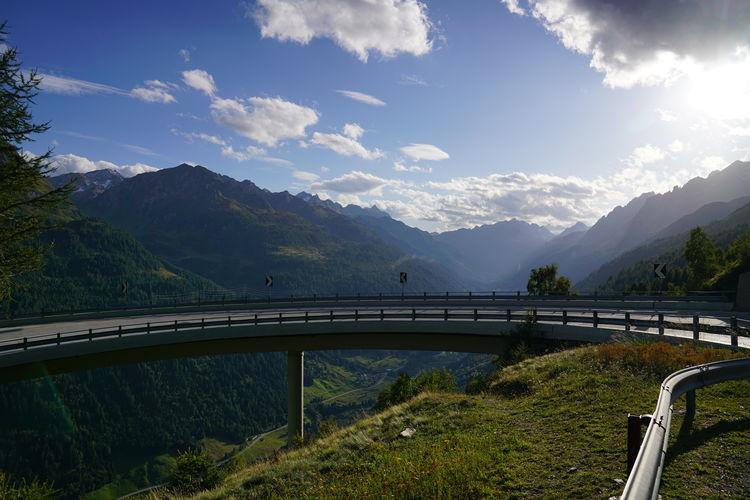 Bridge over mountains against sky