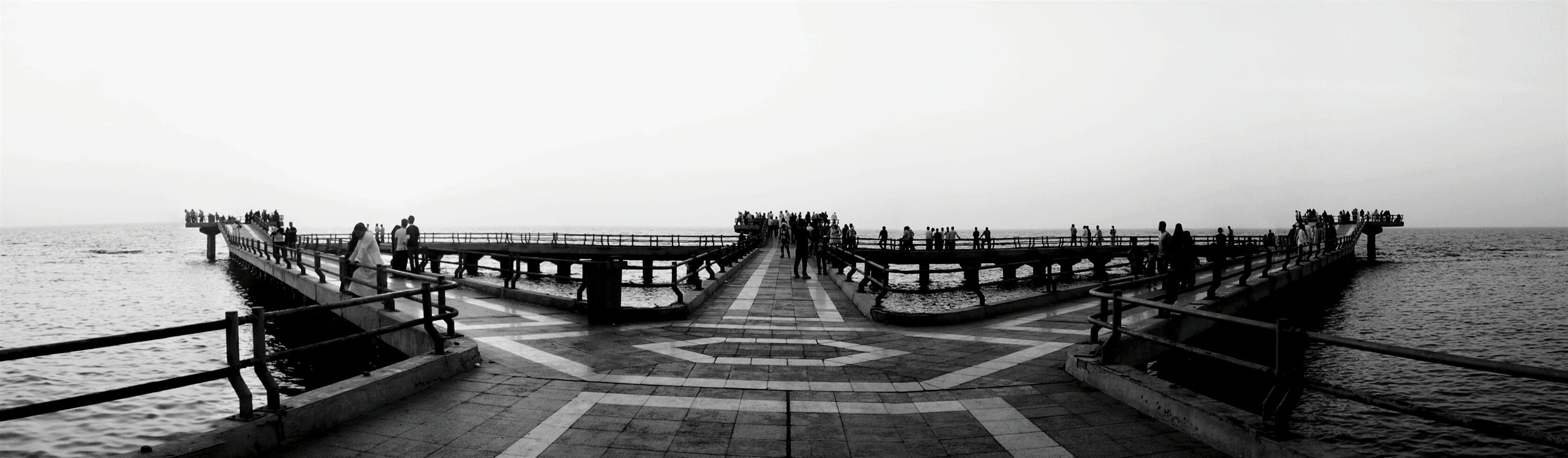 sea, water, pier, horizon over water, clear sky, copy space, tranquility, tranquil scene, beach, railing, scenics, the way forward, jetty, nature, beauty in nature, sky, incidental people, shore, wood - material, idyllic