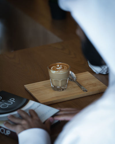 Coffee on Wooden Table with Book in Cafe Ijas Muhammed Photography Drink Food And Drink Refreshment Table Coffee Coffee - Drink Cup High Angle View Indoors  Mug Wood - Material Coffee Cup Selective Focus Drinking Glass Glass Freshness Still Life Food No People Communication Tray