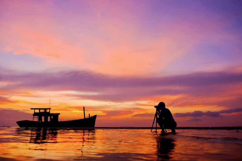 Sunset Sky Water Nautical Vessel Sea Cloud - Sky Silhouette Real People Transportation Orange Color Scenics - Nature Mode Of Transportation Beauty In Nature Waterfront Lifestyles Men Idyllic Two People Outdoors Horizon Over Water